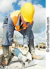 builder working with cutting grinder saw - Builder worker...