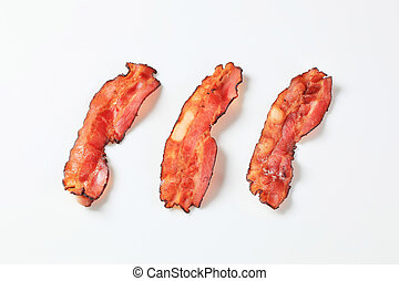Fried bacon strips - Crispy pan-fried strips of bacon