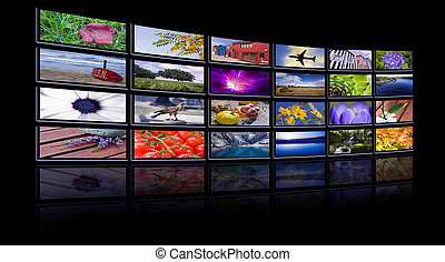 tv screens with reflections on black background
