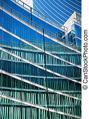 Glass facade of office building with reflection