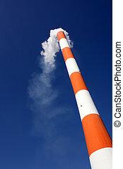 Smokestack on a blue sky background