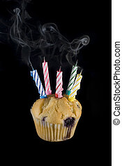blown out candles - a cupcake and candles that have just...