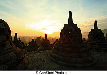 Borobudur Sunrise - Silhouette of Ancient stupa Borobudur...