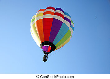 Hot air balloon against clear blue sky background