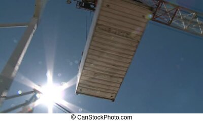 Container loaded to ship - container being loaded overhead...
