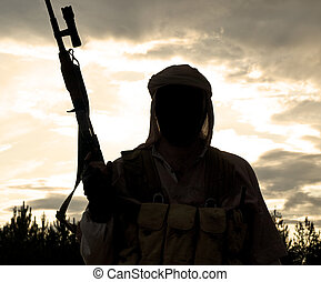 muslim militant - Silhouette of muslim militant with rifle