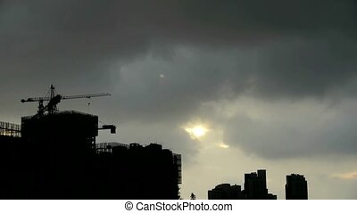 Clouds cover sun sky,building high-rise,House silhouette