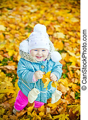 Laughing Girl With Yellow Leaf