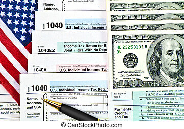 Tax forms with pen, money and US flag - Tax forms 1040 with...