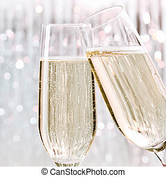 Skoal - Two elegant flutes of sparkling white champagne with...