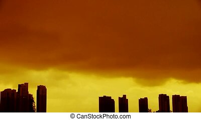 Dark clouds cover sun sky,building