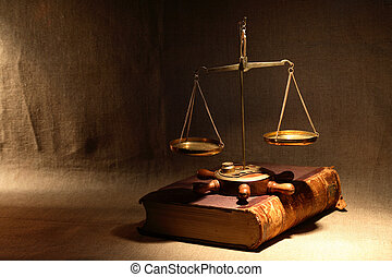 Code Of Laws - Legislation concept Old brass weight scale...