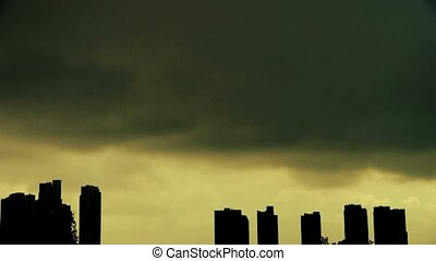 Dark clouds cover sun sky,building high-rise,House...