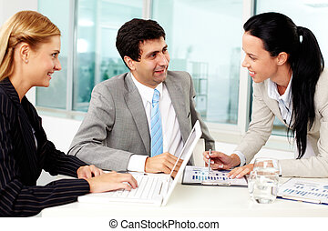 Work in group - Three business people discussing ideas at...