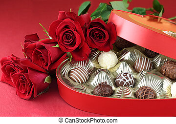 Candy and Roses - Heart shaped box filled with a variety of...