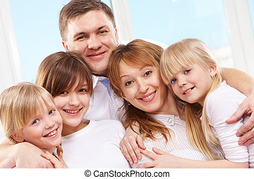 Parents and daughters - A young friendly family looking at...