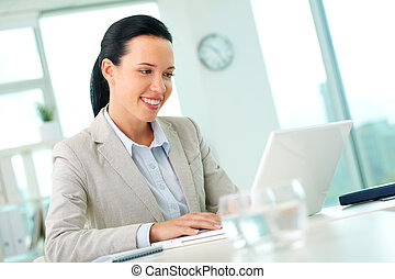 Secretary working - Portrait of pretty secretary looking at...