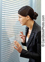 What is going on? - Image of puzzled businesswoman looking...