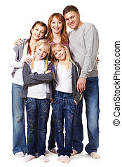 Casual fashion - A young friendly family looking at camera...
