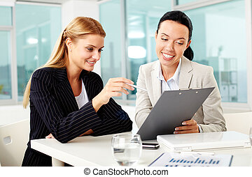 Discussion of plan - Portrait of two young women at...