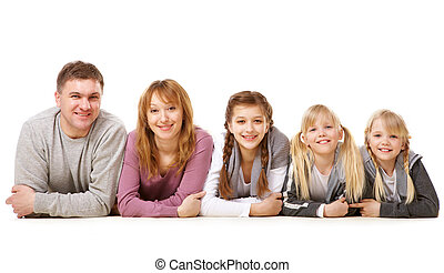 Parents and children - A young friendly family looking at...