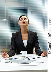 Meditating employer - Image of young employer at the table...