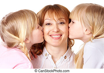 Kissing mother - Happy woman looking at camera while being...
