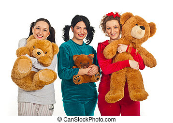 Cheerful women in pyjamas with teddy bears - Three women in...