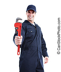 Plumber with an adjustable wrench. - Smiling handsome...
