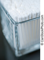 Cotton buds in a glass corner view close up