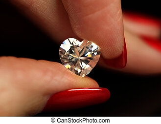 Fingers holding heart shape diamond - Fingers with red nails...
