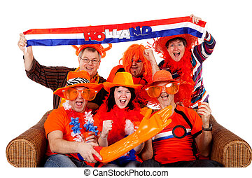 Group of Dutch soccer fan watching game over white...