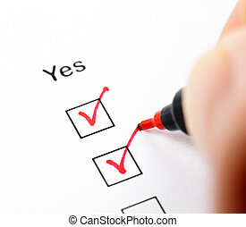 Answering Yes - Hand with pen marks the check box Yes