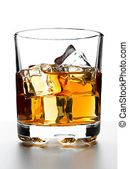 Whisky with ice - Glass of whisky with ice on a white...
