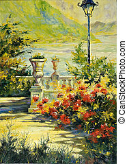 Terrace with flowers and a lantern on coast of lake