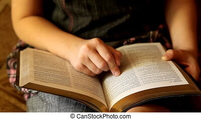 Bible - A young girl reading the Bible