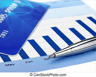 Pen on the chart - Credit card and pen on the chart