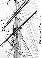 Mast79jpg - Detail view of a sailboat mast in black and...