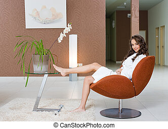 The spa experience. - Gorgeous young brunette girl relaxing...
