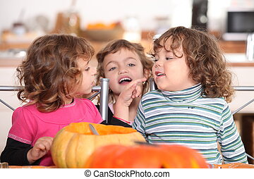 three kids in a kitchen at Halloween time