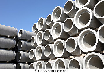 concrete pipes - stack of concrete pipes, industrial site