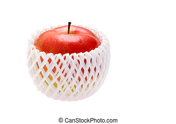 apple in net - apple in packing net on a white background