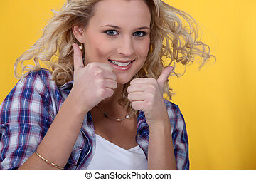 Blond woman giving thumbs-up