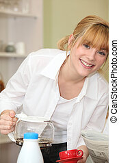 fair-haired girl pouring coffee