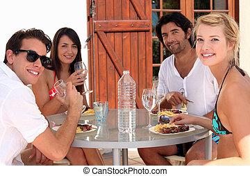 Young people eating alfresco