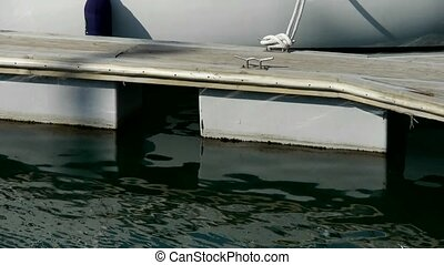 Plank Road reflection in water at Pier of QingDao city...