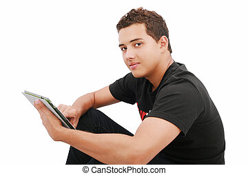 A smiling man sitting on the floor with a tablet, isolated...