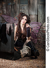 Smoking Fairy - Tough fairy smokes cigarette in a rustic...