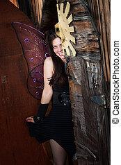 Shy Fairy - Beautiful shy fairy hides behind old door