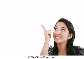 Attractive young woman points to something above her head